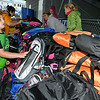 5-year-old Beckley resident Hunter Preston Smith looks over the hundreds of available backpack styles as he tries to make a choice Saturday afternoon at Linda K. Epling Stadium. Parents brought their kids out to the ballpark for the 3rd annual Operation Family Freedom, an event featuring music, activities and the opportunity to get free clothing and a backpack loaded with school supplies, which were provided by volunteers from Pleasant Ridge Baptist Church in State Road, North Carolina.<br /> Brad Davis/The Register-Herald