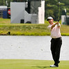George McNeill shoots from the fairway on 16 during the final round of the Greenbrier Classic Sunday in White Sulphur Springs.<br /> Brad Davis/The Register-Herald