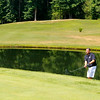 Mullens resident Jonathan Forren chips onto the green at the Brier Patch Golf Course Saturday morning during the 34th annual BNI tournament.<br /> Brad Davis/The Register-Herald