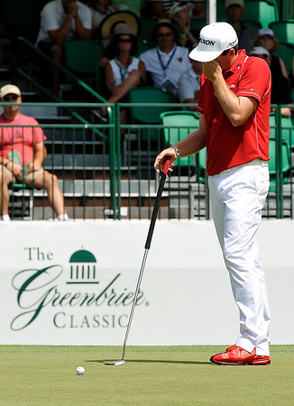 Keegan Bradley reacts after his putt comes up short on 16 during the final round of the Greenbrier Classic Sunday in White Sulphur Springs.<br /> Brad Davis/The Register-Herald