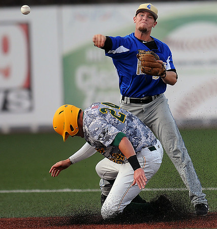 West Virginia Miners David Martinelli tries to break up the double play by Champion City's Tanner Reibenspies during Friday evening action at Linda K. Epling Stadium. F. Brian Ferguson/The Register-Herald
