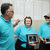 David Hunter, left presented, Chastain Flournoy, daughter of Beth Hanna, the honoree of the BNI Tournament and Pat Hanna, husband of Beth, a plague of appreciation.<br /> Rick BArbero/The Register-Herald
