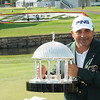 Angel Cabrera holds up the trophy after winning The Greenbrier Classic.<br /> Rick Barbero/The Register-Herald