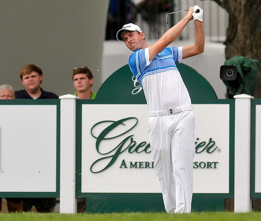 Webb Simpson tees off on 18 during the final round of the Greenbrier Classic Sunday in White Sulphur Springs.<br /> Brad Davis/The Register-Herald