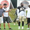 Tony Gibson, WVU defensive coordinator, left, watches the New Orleans Saints practice from the sideline.<br /> Rick Barbero/The Register-Herald