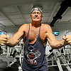 77-year-old Beckley resident Tom Rapp works out on a cable crossover machine Monday morning at L.A. East Fitness. The ageless Rapp works out at the Appalachian Drive location four times a week and is usually joined by others his age.<br /> Brad Davis/The Register-Herald