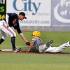 West Virginia's Mike Brosseau is out by a mileafter being picked off at first as Chillicothe shortstop Greg Rhude is already waiting for him to make an easy tag Monday night at Linda K. Epling Stadium.<br /> Brad Davis/The Register-Herald