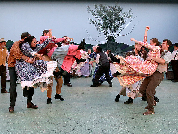 Hatfield (right) and McCoy (left) women are separated by their kin after the two families engaged in a round of fisticuffs during a scene from Theatre West Virginia's Hatfields & McCoys Friday night at Grandview Park's Cliffside Amphitheatre.<br /> Brad Davis/The Register-Herald