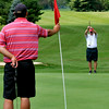 Daniels resident John Scott, right, lines up his next putt as his group partner Jason Monroe Halstead gets ready to pull the flag out during the second day of BNI tournament action Sunday morning at Grandview Country Club.<br /> Brad Davis/The Register-Herald