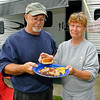 Phillip and Becky Weaver show off the finished product, a hearty breakfast fit for a camper, early Sunday morning at the Lake Stephens RV campground. The former Lincolnton, North Carolina residents spend virtually every weekend camping at Lake Stephens, and they've quickly developed a tradition of making one of the best homemade, open fire-cooked breakfasts around. They now live in the Morgan Hills area, and word of the Weavers' awesome biscuits is beginning to spread outside the campground thanks to camping neighbors lucky enough to get a shot at whatever's left over.<br /> Brad Davis/The Register-Herald
