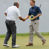 Angel Cabrera shakes hands with Billy Hurley III after winning The Greenbrier Classic.<br /> Rick Barbero/The Register-Herald