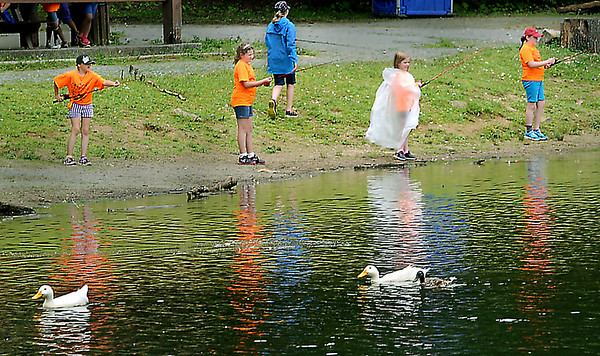 Neither girl scouts nor small water fowl were discouraged from fishing during Wednesday's on-again, off-again rain showers at Little Beaver Lake. Girl Scouts from all Raleigh County Troops enjoyed an organized day of fishing, hiking,  and cooking out.  F. Brian Ferguson/The Register-Herald