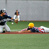 West Virginia's Read Brown dives into third base as Butler third baseman Nick Sell can't reach the errant throw that goes past him Tuesday night at Linda K. Epling Stadium.<br /> Brad Davis/The Register-Herald