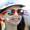 Charleigh Baab, 11, daughter of Chuck and Holley Baab, of Tampa Florida, watching the second round of The Greenbrier Classic.<br /> Rick Barbero/The Register-Herald