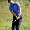 Cameron Tringale chips onto the green at 17 during the final round of the Greenbrier Classic Sunday in White Sulphur Springs.<br /> Brad Davis/The Register-Herald