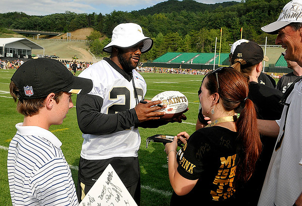 Running back Mark Ingram signs autographs for fans after practice Saturday afternoon in White Sulphur Springs.