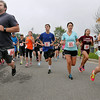 Runners take off from the starting line during the 5K portion of the Fast & Furriest 5K Run/1 Mile Walk Saturday morning at the YMCA Paul Cline Memorial Youth Sports Complex. Participants could run the 5K, or take a nice walk with their pets during the event, and proceeds benefitted the Humane Society of Raleigh County.<br /> Brad Davis/The Register-Herald