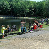 The scene during the 23rd Annual Kids Fishing Derby Saturday morning at Little Beaver State Park. Hundreds of kids 14 and under flocked to the lake area at Little Beaver, taking up almost every foot of space available along the lake's edge for as far as one could see.<br /> Brad Davis/The Register-Herald
