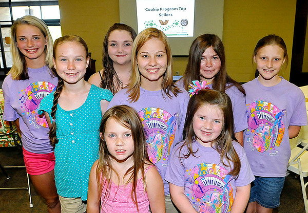 Area girl scouts from four different troops pose for a quick photo prior to an awards ceremony for the year's top cookie sellers at United Methodist Temple Saturday afternoon. From left to right (back row) are Fancy Taylor, Gillian Breeden, Arin Dorsey, Jasmine Earp, Deanna Damron and Rachael Stone, while Lila Davis and Olivia Burks make up the front row. Each scout here was honored for selling over 1,000 boxes of girl scout cookies while Earp (center) sold an astonishing 6,008 boxes.<br /> Brad Davis/The Register-Herald