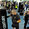 Kickboxing instructor Dave Krass (lower middle) leads a class June 10 at the YMCA of Southern West Virginia.<br /> Brad Davis/The Register-Herald