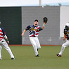 West Virginia second baseman Ryan Perkins (#13) looks on as center fielder David Martinelli (middle) and right fielder Westyn Baylor (right) avoid a collision as Martinelli makes the catch against the Champion City Kings Monday night at Linda K. Epling Stadium.<br /> Brad Davis/The Register-Herald