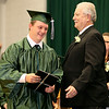 Wyoming East graduating senior Coty Bishop collects his diploma June 1 in New Richmond.<br /> Brad Davis/The Register-Herald