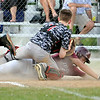 Woodrow Wilson's Hunter Halstead (lower) manages to slide underneath the tag of Pikeview catcher Seth Meadows to score a run during the Flying Eagles' slugfest win Friday evening in Shady Spring.<br /> Brad Davis/The Register-Herald
