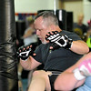 Kickboxing instructor Dave Krass joins in on the fun as he leads his class during a session June 10 at the YMCA of Southern West Virginia.<br /> Brad Davis/The Register-Herald