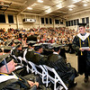 A Westside grad makes his way back to his seat after collecting his diploma Sunday afternoon in Clear Fork.<br /> Brad Davis/The Register-Herald