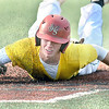 Beckley Post 32's #21 slides safely bach to first against South Charleston Post 94 during Tuesday evening action at Linda K. Epling Stadium.  F. Brian Ferguson/The Register-Herald