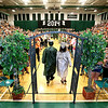 Graduating seniors from Wyoming East High School make their way to the stage to join the rest of their classmates at the start of the school's commencement ceremony Sunday evening in New Richmond. <br /> Brad Davis/The Register-Herald