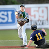 West Virginia Miners second baseman #13 turns the double-play as Richmond's #11 slides into second in the second inning of Wednesday action in Beckley. F. Brian Ferguson/The Register-Herald