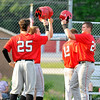 St. Albans first baseman Chandler Hunter, far right, is congratulated by three of his Red Dragon teammates at home plate after his 1st inning grand slam contributed to a 5-run opening frame against Wyoming East Friday evening in Shady Spring.<br /> Brad Davis/The Register-Herald