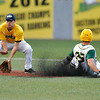 West Virginia's Paul Trenhaile slides safely into second base as Richmond's Will Farmer catches a late throw during the bottom of the third inning Monday night at Linda K. Epling Stadium. A Miner's run would score on the play.<br /> Brad Davis/The Register-Herald