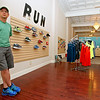 Terry Hoskins, owner of the newly-opened Beckley Running Supply at 118 Main Street, poses for a photo inside the store Friday afternoon. His business opened its doors on Tuesday and now provides the downtown area with every need a runner could have, from shoes to clothing and training equipment. <br /> Brad Davis/The Register-Herald