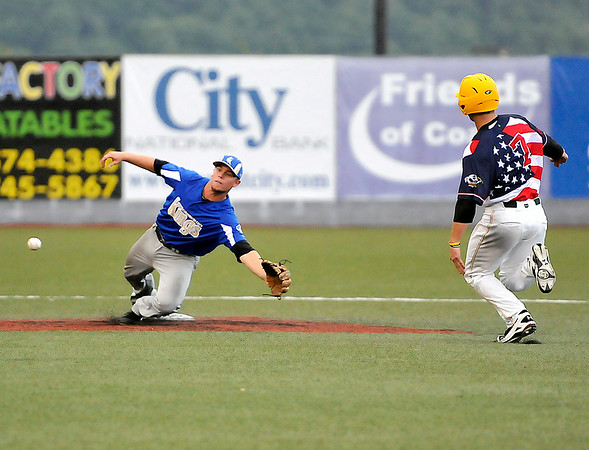 West Virginia's Grant Massey steals second base as Champion City infielder Tanner Reibenspies has to dive to take the throw June 23 at Linda K. Epling Stadium.<br /> Brad Davis/The Register-Herald