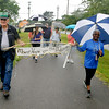 "Jim ""Sarge"" Helton and Jean Evansmore of Mount Hope on the Move came out to show their support despite the rain during the Stop the Violence Walk Saturday morning at the Oak Hill railroad depot. Area residents walked the White Oak rail trail in sporadic rain to show support and solidarity for a woman who was sexually assaulted along the trail last week, and every bit of the proceeds from a raffle and donation drive went to help with her medical expenses. The event was put on by a combination of concerned citizens and the Fayette County Women's Resource Center.<br /> Brad Davis/The Register-Herald"