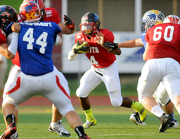 Oak Hill's Jalen Jones carries the ball Saturday night during the North South All-Star game in Charleston.<br /> Brad Davis/The Register-Herald