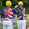 West Virginia's Zach Woolcock (right) is congratulated at home plate by teammate David Martinelli after the two came in to score on a 2-run triple by Read Brown to take an early lead against the Champion City Kings Monday night at Linda K. Epling Stadium.<br /> Brad Davis/The Register-Herald
