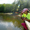 Beckley residents Indiya Lawson (near), 11, and Daylen Thomas, 6, watch bluegill methodically avoid their hooks as they fish from a dock during the 23rd Annual Kids Fishing Derby Saturday morning at Little Beaver State Park. Looking down from here you could the fish through the water, seemingly experienced at avoiding capture, picking away at their bait but never taking the hook, which early on made for a slightly frustrating first fishing experience for young Daylen. <br /> Brad Davis/The Register-Herald