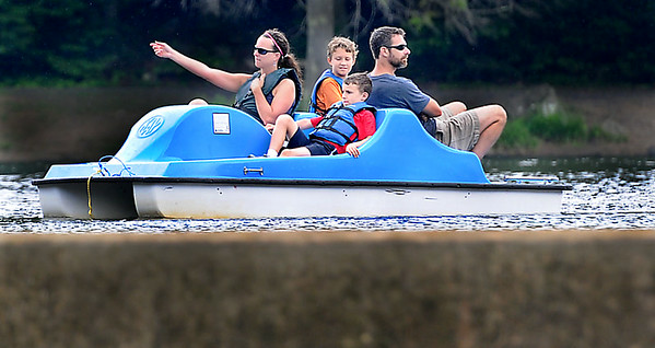 The Kovacsev Family, (from left), Daniela, Nicholas, Noah, and Jason take in a paddle boat ride, between Thursday rain showers at Little Beaver Lake. The family made the trip from Orlando, FL. to take in whitewater rafting and as many state parks as they could find. F. Brian Ferguson/The Register-Herald