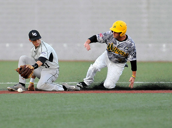 West Virginia's Grant Massey steals second base as Lorain County infielder Addison Rospert can't handle the throw during the bottom of the 4th inning of Miner's 2-1 over the Ironmen Monday night at Linda K. Epling Stadium.<br /> Brad Davis/The Register-Herald
