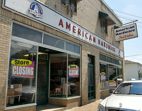 Signs announcing the closure of American Hardware hang in the windows of the 212 Main Street business Friday afternoon in Mount Hope. After 65 years in the community, owner Bob Dorado is shutting the doors on American Hardware for good sometime after August 1st.<br /> Brad Davis/The Register-Herald