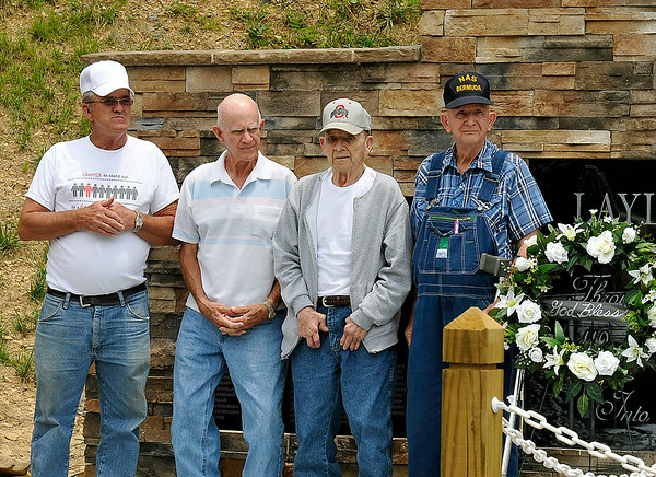 (L to R) Stanley McClanahan, Bill Hornsby, Marvin Fitzpatrick and Wayne Hornsby gather for photos in front of the brand new monument built to honor the 112 men who died and the 54 that survived when a massive explosion occurred in the Layland #3 mine March 2, 1915 during a dedication ceremony Saturday afternoon. Each lost relatives in the blast. McClanahan's great uncle, Homer Goddard, was one of the victims. Cousins Bill and Wayne Hornsby lost their great uncle James Hornsby in the disaster. However, Fitzpatrick lost a grandfather, a great uncle and several cousins, while another uncle survived the accident only to lose his life in another mine explosion two years later.<br /> Brad Davis/The Register-Herald