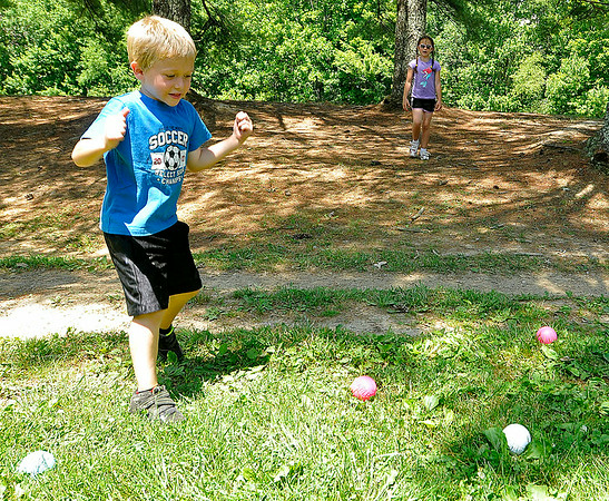 Rats! Big sister wins again! Cayden finds that Madelyn has gotten her murbles closer to the point ball June 16 at Pipestem State Park.<br /> Brad Davis/The Register-Herald