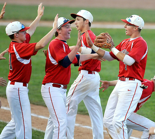 Independence shortstop Wyatt Adkins, far right, is congratulated by jubilant teammates after he and second baseman Brad Huffman combined to turn a crucial double during the third inning of the Patriots' 11-6 win over Fairmont Senior in State Tournament action Friday night in Charleston. Brad Davis/The Register-Herald