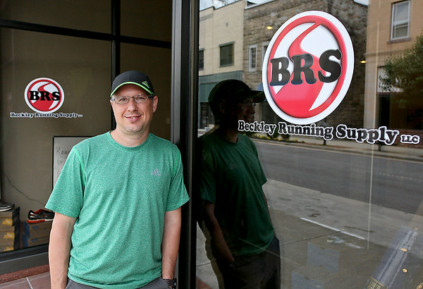 Meet local resident Terry Hoskins, owner of the newly-opened Beckley Running Supply at 118 Main Street. His business opened its doors on Tuesday and now provides the downtown area with every need a runner could have, from shoes to clothing and training equipment. <br /> Brad Davis/The Register-Herald