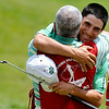 Hurricane's Brian Anania hugs his dad Geno after winning the West Virginia Amateur Friday afternoon on the green of the Old White No.18 in White Sulphur Springs. Geno caddied for Brian, who shot an even par 70 on Friday and a 1-over 281 for the tournament.<br /> Brad Davis/The Register-Herald
