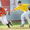 Beckley Post 32 pitcher #4, right, puts a tag on  South Charleston Post 94's  #11, left, during a run-down at third base during Tuesday evening action at Linda K. Epling Stadium.  F. Brian Ferguson/The Register-Herald