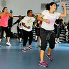 Zumba instructor Celi Van Dyke, right, leads a class in a fast-paced workout Monday evening at the YMCA of Southern West Virginia.